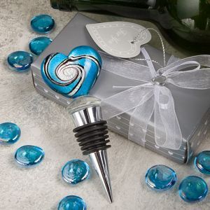 "Each chrome finish silver metal wine bottle stopper favor measures 4"" x 1 ½"" and has a conical base, wrapped with a black rubber gasket, topped with a solid glass heart shaped charm, hand painted in a swirl design with silver, black and blue."